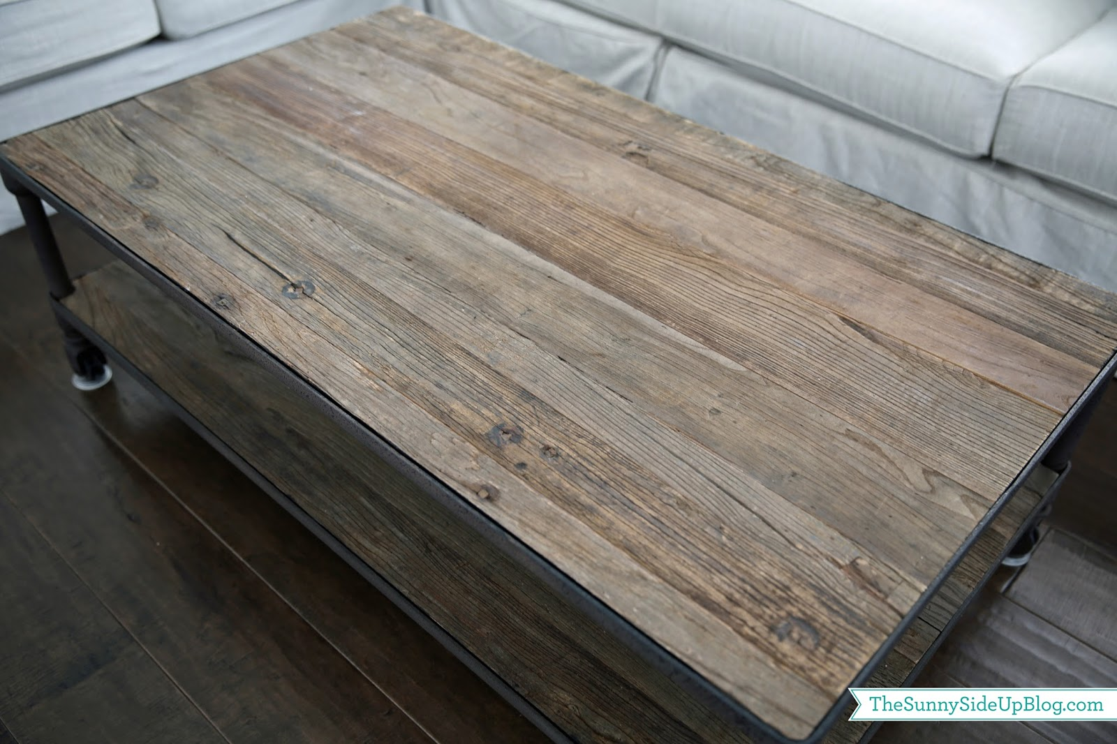 Reclaimed wood farmhouse vibe so this look really appeals to me not so much to my mom who pointed out when she was here last that my coffee table