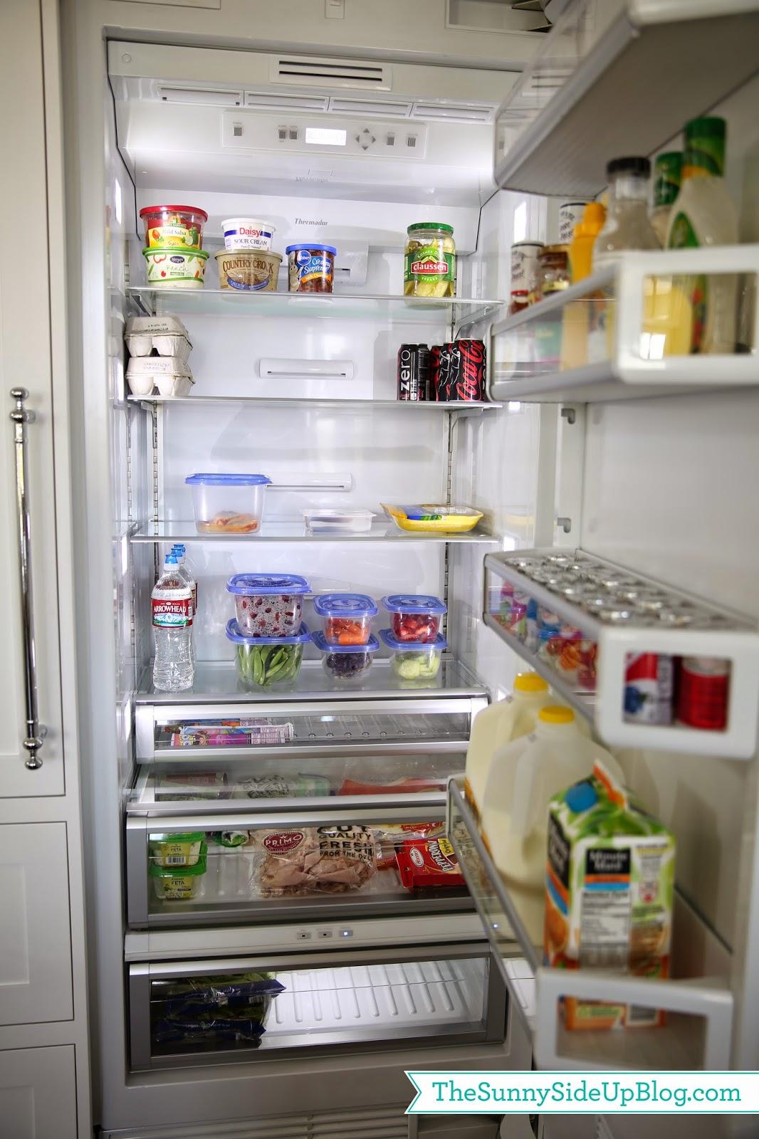 Organized kitchen drawers and fridge
