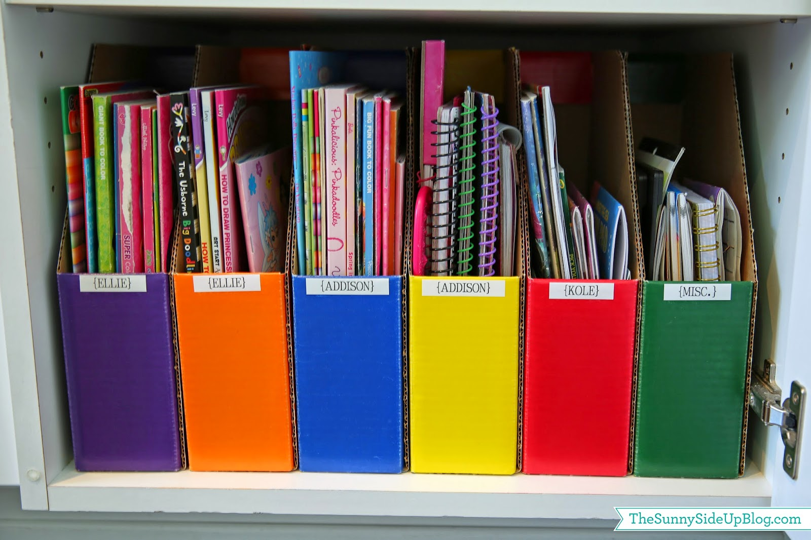 Coloring books and story books can be stored in DIY magazine holders.