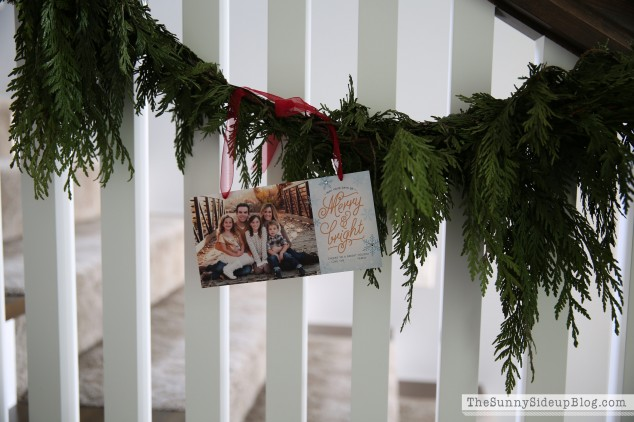 christmas-card-on-stair-garland