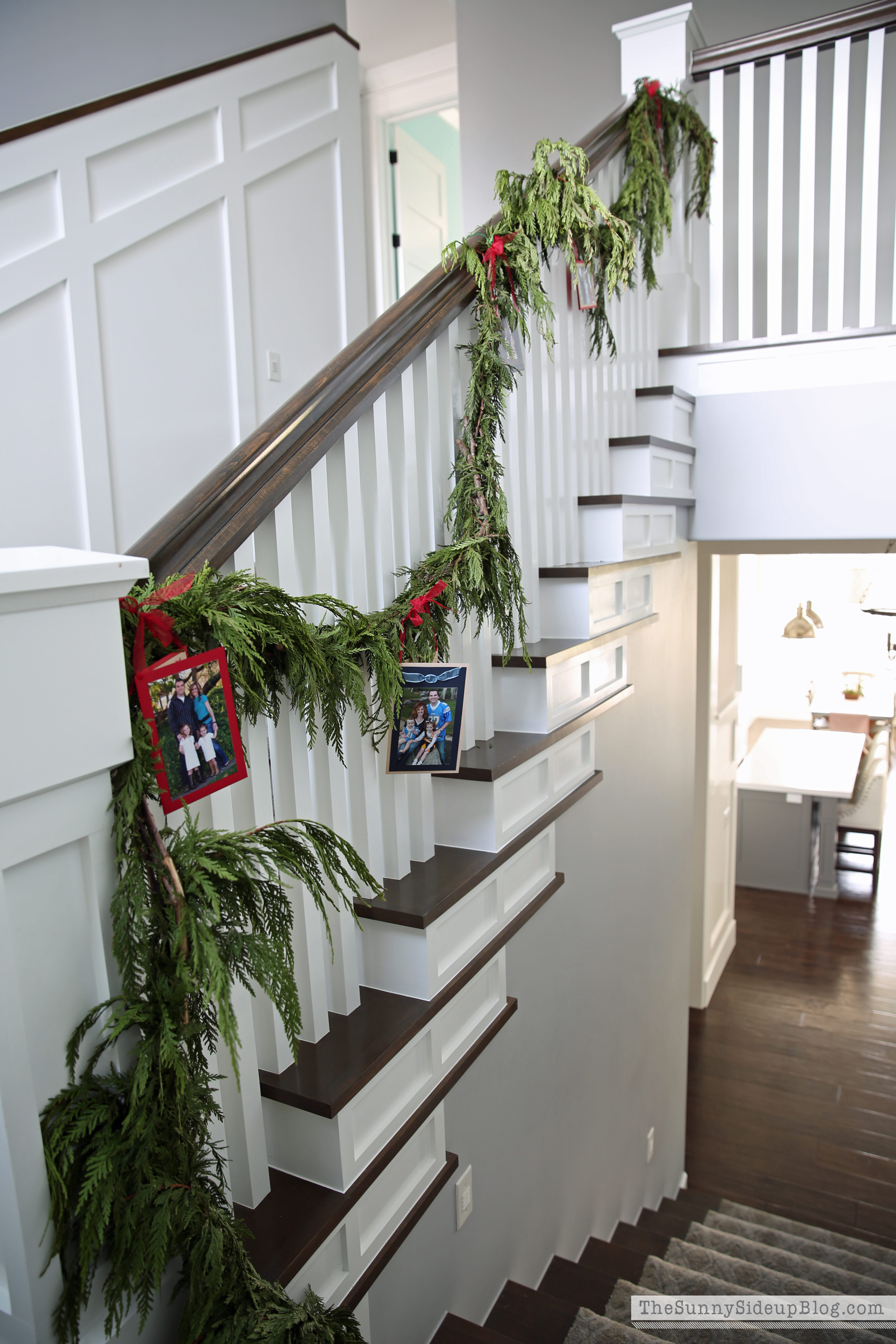Fresh Garland And Christmas Cards On The Staircase