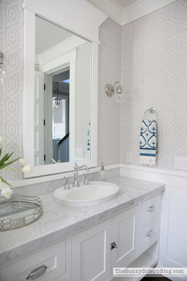white-molding-around-bathroom-mirror