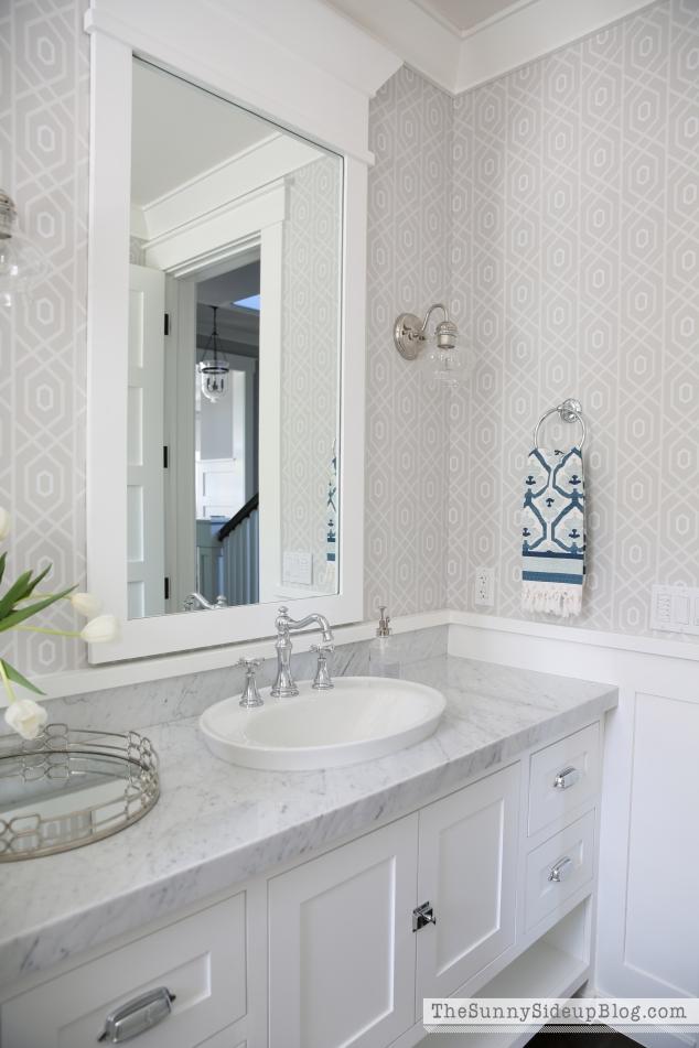white-molding-around-bathroom-mirror