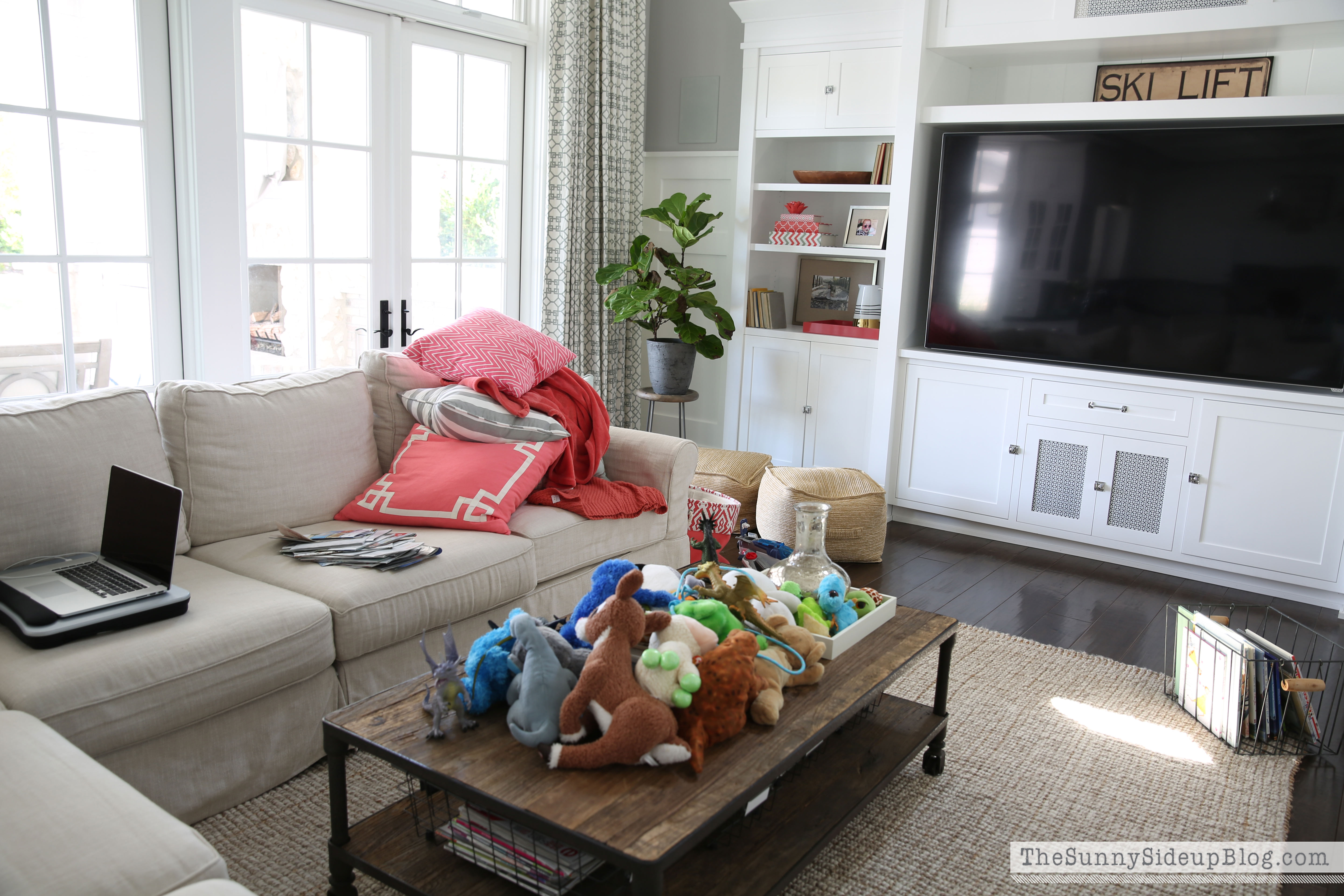 Interior of messy living room with recessed lights on ...