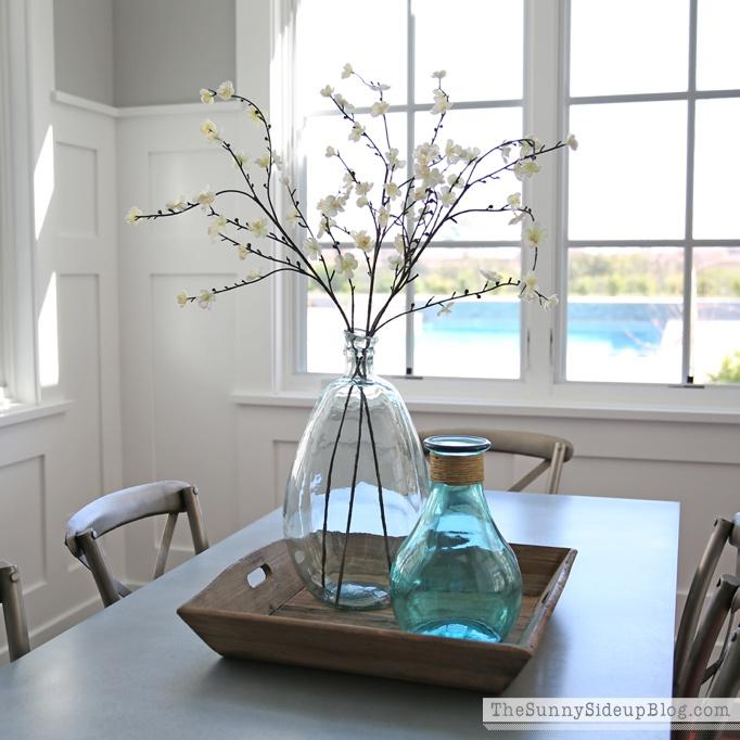 glass jar and flower arrangement