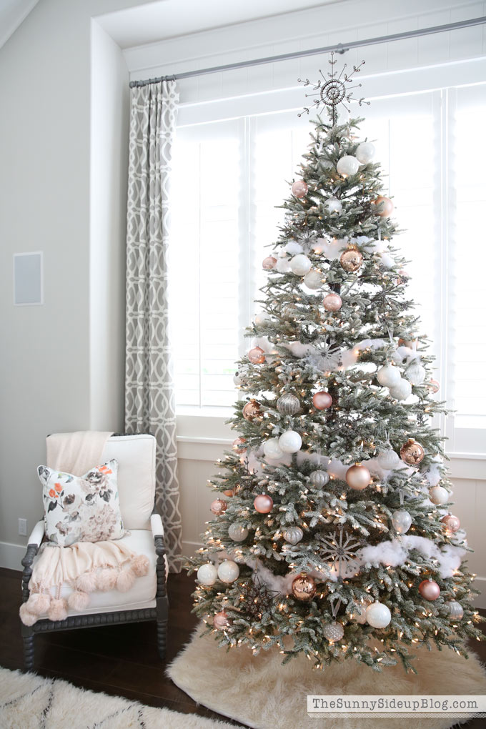 Artificial frosted pink, silver and white Christmas tree