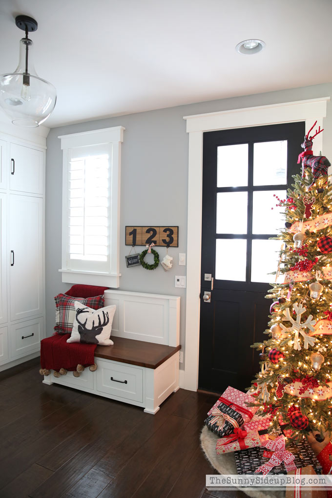 Black dutch door - mudroom with built in cabinets decked for Christmas!