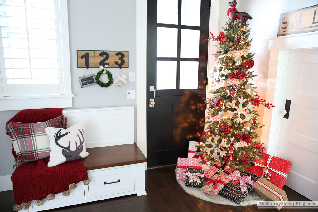 Mudroom with built-in cabinets decked for Christmas!